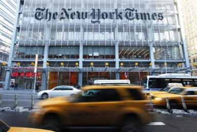Vehicles drive past the New York Times headquarters in New York