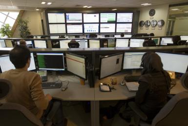 Technicians monitor data flow in the control room of an internet service provider.