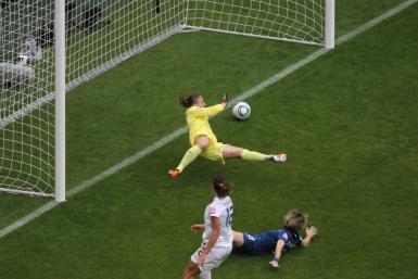 Cheney of the U.S. scores a goal during the Women's World Cup semi-final soccer match against France in Monchengladbach