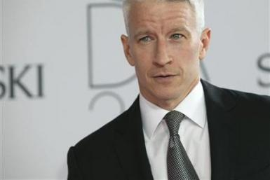 Anderson Cooper poses on the red carpet at the CFDA Fashion awards at the Lincoln Center's Alice Tully Hall in New York City