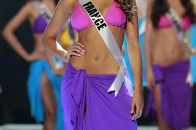 Miss France Laury Thilleman steps forward after being chosen among the final ten contestants of the Miss Universe 2011 pageant in Sao Paulo