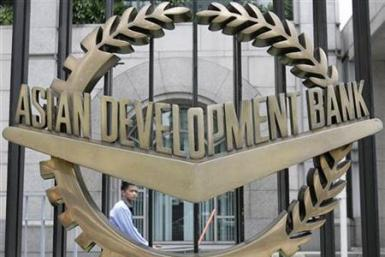 A worker walks past inside the Asian Development Bank headquarters in Manila