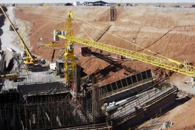 Workers prepare the site of the second mineshaft to be sunk at Oyu Tolgoi in Mongolia