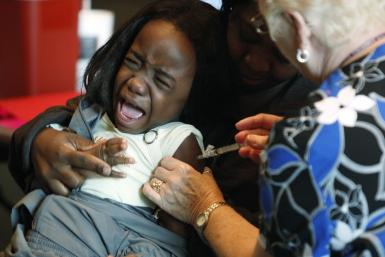 A single shot vaccination will provide protection against all kinds of flu viruses for life including bird flu and swine flu. Here Fofu, 4, screams while her mother Abena holds her as a nurse injects a shot of the H1N1 flu vaccine, in Arlington, Texas No