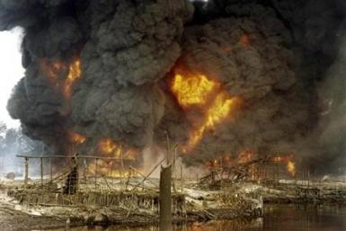 Smoke and flames billow from a burning oil pipeline in Nigeria