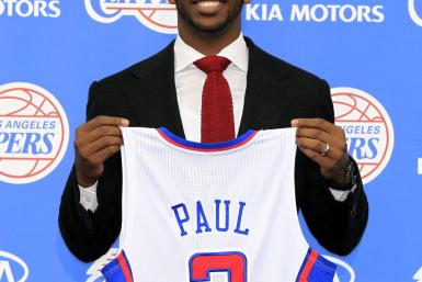 Los Angeles Clippers point guard Chris Paul poses with his new jersey after an introductory news conference in Playa Vista, Los Angeles, California
