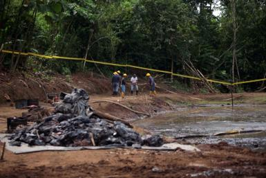 Ecuadorean Workers Clean Up and Oil Waste Pit
