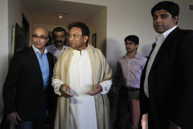 Former Pakistani President Musharraf arrives before his speech, in the commercial centre Karachi, Dubai