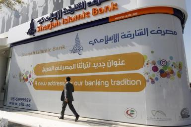 A man walks past a newly-opened Sharjah Islamic Bank branch on Sheikh Zayed road in Dubai