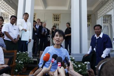 Myanmar's pro-democracy leader Aung San Suu Kyi talks to reporters after meeting France's Foreign Minister Alain Juppe in her home in Yangon January 15, 2012.