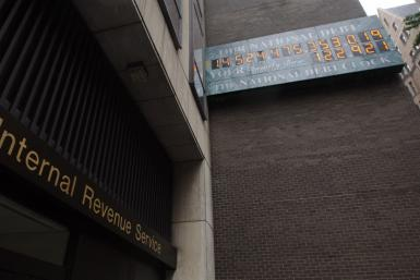 The National Debt Clock hangs on a wall next to an office for the Internal Revenue Service near Times Square in New York