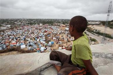A boy sits looking over the Seyidka settlement for the famine stricken internally displaced people in Berkulan near Somalia's capital Mogadishu