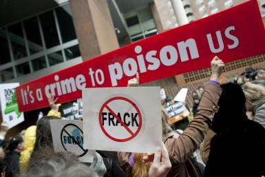 People protest against hydraulic fracturing outside the Tribeca Performing Arts Center in New York
