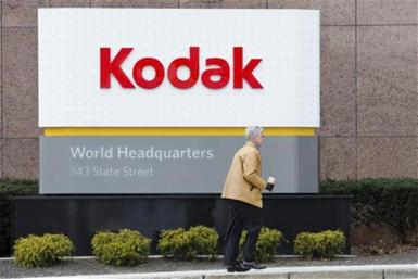 A man walks past the Kodak World Headquarters sign in Rochester, New York