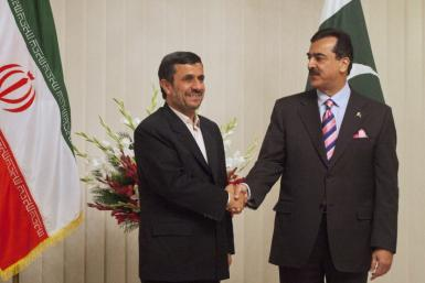 Pakistan's PM Gilani and Iran's President Ahmadinejad shake hands before their meeting in Islamabad