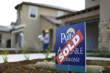 A newly built home is shown as sold in a subdivision under construction in Carlsbad