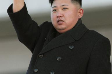 North Korean leader Kim Jong-Un waves during a military parade in Pyongyang