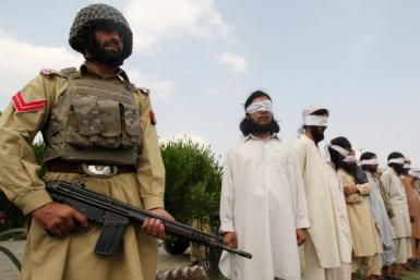 Blindfolded members of Lashkar-e-Islam presented to the media by paramilitary in Jamdrud in August 2008