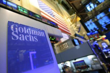 A Goldman Sachs sign is seen on at the company's post on the floor of the New York Stock Exchange, Jan. 18, 2012