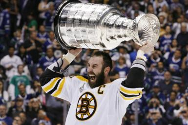 Bruins captain Zedno Chara celebrates with the Stanley Cup.