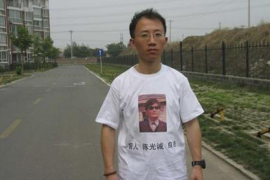 One of China's most prominent dissidents, Hu Jia, wears a shirt in support of blind Chinese lawyer Chen Guangcheng, in this undated handout.