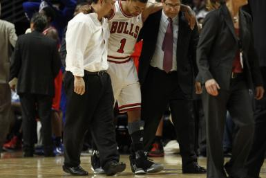 Derrick Rose is helped off the floor after tearing his ACL in his left knee.