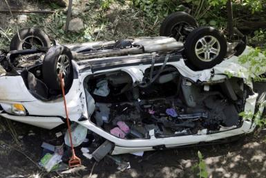 The wreckage of a van that drove off a highway overpass near the Bronx Zoo in New York