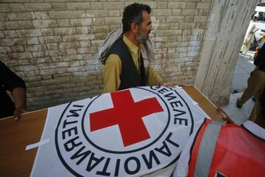 Hospital staff and rescue workers carry the casket of Khalil Rasjed Dale, a British doctor working with the International Committee of the Red Cross, to an ambulance at a hospital in Quetta