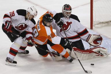 New Jersey Devils Goalie Brodeur makes a save on the Philadelphia Flyers center Briere during their NHL Eastern Conference semifinal playoff hockey series in Philadelphia