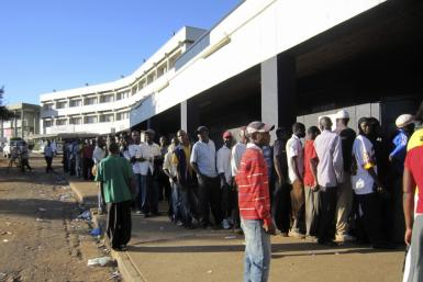 Residents queue up for sugar at a supermarket in the Malawian capital of Lilongwe