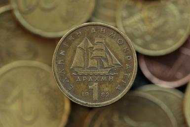 A drachma coin is seen on display in this photo illustration taken in Athens May 9, 2012.