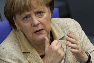 German Chancellor Merkel attends a debate after delivering statement on her government policies in Berlin