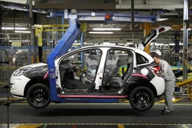 File picture of an employee working on the assembly line of the Citroen C3 at the PSA Peugeot Citroen plant in Poissy