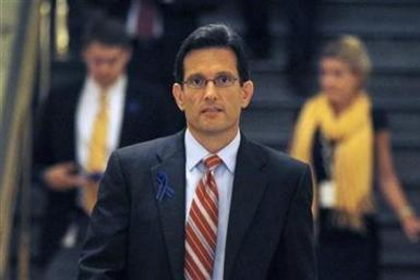Rep. Eric Cantor (R-VA) walks to a meeting of the Republican caucus on U.S. debt reduction talks on Capitol Hill in Washington