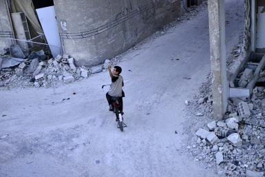 Boy on bike in Syria