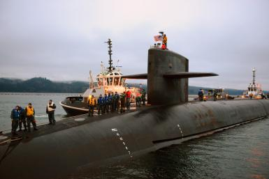 A nuclear submarine prepares for docking at its base in Washington.