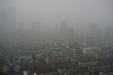 """China plans to combat Beijing air pollution by creating """"green necklace"""" around city."""