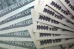 File photo of Japanese 10,000 yen notes spread out next to U.S. dollar bills at an Interbank Inc. money exchange office in Tokyo