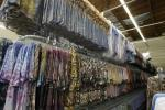 Racks of women's t-shirts are stacked in the warehouse at the Sledge USA clothing factory in Los Angeles October 13, 2009. U.S. store chains are hedging a major bet they made this year by slashing inventories, sometimes as much as 25 percent, to make sure