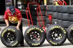 A crew member of Kevin Harvck's number 29 Chevrolet lines up Goodyear tires during the final practice session for the Daytona 500 NASCAR Sprint Cup Series race at the Daytona International Speedway in Daytona Beach, Florida February 14, 2009