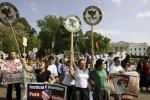 Latino demonstrators protest outside the White House during a May Day march in Washington, May 1, 2009.