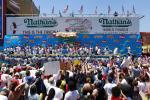 Contestants take part in Nathan's annual hot dog eating contest in the Coney Island section of New York