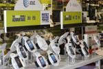 AT&T mobile phones are seen for sale alongside T-Mobile phones at a RadioShack electronics store in Los Angeles