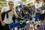 Young men smoke from a vapor pipe and water pipe at the The Wonders of Cannabis Festival in San Francisco