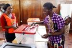 A mother casts her vote during the Zambian presidential election,