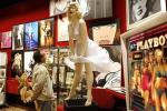 A visitor looks at a sculpture of Marilyn Monroe in the showroom of Drouot auction house in Paris