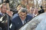 Joe Paterno getting out of car