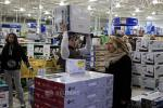 """A shopper carries an item on his head as he shops on the shopping day dubbed """"Black Friday"""" in Framingham"""