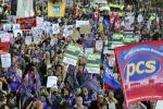 Public service union demonstrators take part in a protest march in Leeds