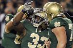 Notre Dame football players celebrate a touchdown against Army
